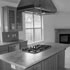 Plan 6 - 4 bedroom / 2.5 bath - 2384sf - kitchen interior - range hood and granite counters